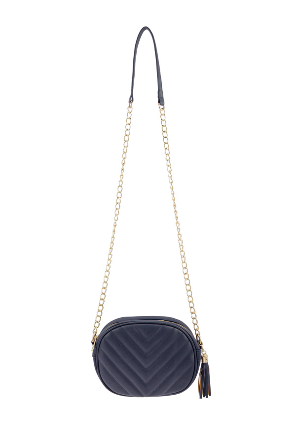Quilted Oval Faux Leather Shoulder Bag With Tassel