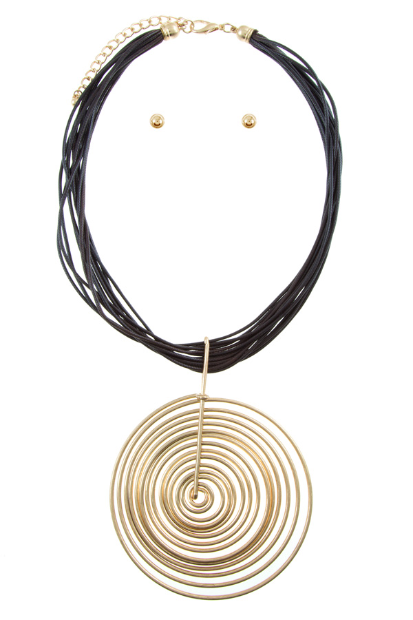 Metal swirl charm on layered rope necklace